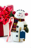 Snowman with package and candy cane on white — Stock Photo