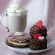 Decadent pastries and mug of chocolate mocha frappuccino with whipped cream — Stock Photo #40572493