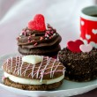 Fancy pastries and a red and white heart mug of coffee — Stock Photo #40572487