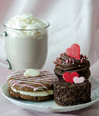 Pastries and mug of chocolate mocha frappuccino with whipped cream — Stock Photo