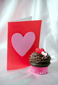Valentine with chocolate frosted cupcake — Stockfoto