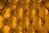 Luxury upholstery leather button chair texture in gold — Stock Photo