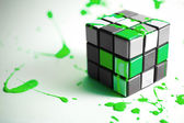 Colorful Green Cube on White surface with Paint — Stock Photo