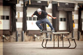Skateboarder doing a Crooked Grind on a Picnic table — Stock Photo