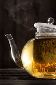 Chamomile Tea in a Clear Teapot — Stock Photo