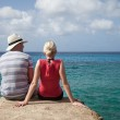 Beautiful Couple sitting on a rock and Looking at The View — Stock Photo #42824641
