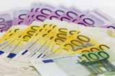 Isolated stack of money with 100 200 and 500 euro banknotes — Stock Photo