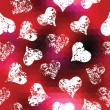 Grunge hearts on red pixels background — Stock vektor