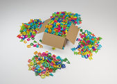 Box overfull by colored letters — Stock Photo