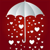 Hearts rain through umbrella — Stock Photo