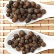 Allspice on spoon — Stock Photo