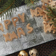 Happy xmas gingerbread with christmas decorations on silver plate — Stock Photo #37310999