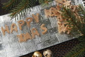 Happy xmas gingerbread with christmas decorations on silver plate — Stock Photo
