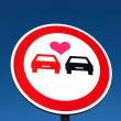 Постер, плакат: Overtaking sign with a love heart between the cars Car lover