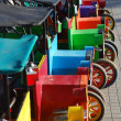 A row of small colourful colorful old cars — Stock Photo