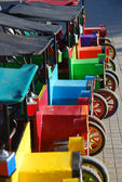 A row of small colourful colorful old cars — 图库照片