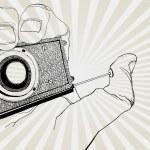 Hand Holding Camera — Stock Vector