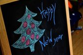 "The inscription and drawing trees on the blackboard ""happy New year"" — ストック写真"