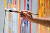 Professional painter at work, painting a street wall — Stock Photo