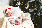 New year baby under the christmas tree — Stock Photo