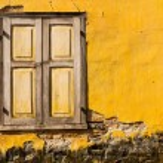 Vintage windows on old yellow brick wall — Stock Photo #31349999