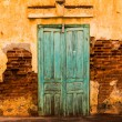 Stock Photo: Wooden green door on old cement wall