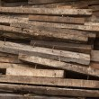 Stock Photo: Stack of wooden bars at construction site