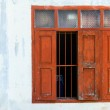 Red wooden window with white wall — Stock Photo #31385075