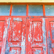 Red wooden window with white wall — Stok fotoğraf