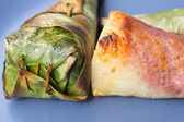 Sticky rice roast , wrapped in banana leaves. — Stockfoto