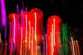 Speed of umbrellas neon light — Stock Photo