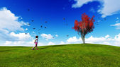 Girl in a meadow with blue sky — Стоковое фото