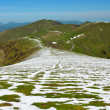 Green mountain ridge with snowfields of the spring Pyrenees — Stock Photo