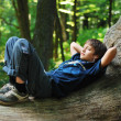 Boy with gadget in forest — Stock Photo