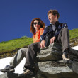 Happy man and woman in mountains — Stock Photo