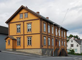 Ancient house in the modern street of Tromso. — Stock Photo