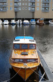 Mooring motorboat on river in city. — Foto Stock