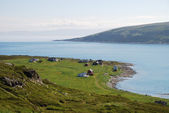 View of Mageroya with small fishing village near blue fjord. — Stock Photo