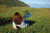 A woman resting near the stream — Stock Photo