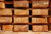 Wooden boards on racks. — Stock Photo