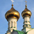 Golden church domes against the blue sky — Stock Photo