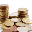 Columns of coins among specie's pile — Stock Photo