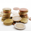 Columns of coins among specie's pile — Stock Photo #33998875