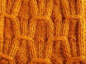 Backgrounds of orange needlework. — Stock Photo
