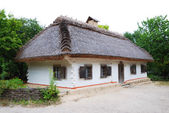 Ancient Ukrainian house thatched — Stock Photo