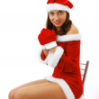 Happy Santa in short dress and mittens — Stock Photo