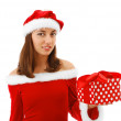 Pretty Santa with a christmas gift — Stock Photo