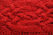 Close-up of knitted cloth with raised plaits. — Stock Photo