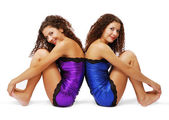 Female twins back to back. Sign of gemini. — Stock Photo