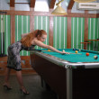 Stock Photo: Attractive girl playing billiards
